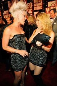whoa now?! pink and shakira